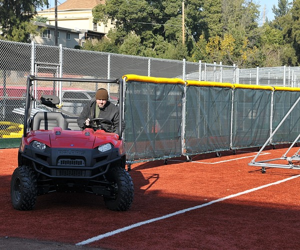 Cart pulling wheeled sections of sportafence