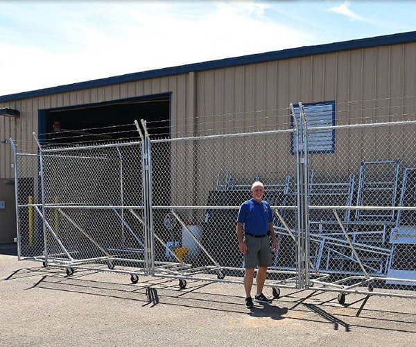 wheeled 10 x 10 foot security fence with Barbwire add-on